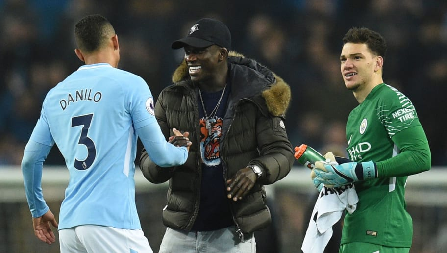 Manchester City's French defender Benjamin Mendy (C) greets Manchester City's Brazilian defender Danilo (L) as Manchester City's Brazilian goalkeeper Ederson (R) looks on at the end of the English Premier League football match between Manchester City and Bournemouth at the Etihad Stadium in Manchester, north west England, on December 23, 2017. / AFP PHOTO / Oli SCARFF / RESTRICTED TO EDITORIAL USE. No use with unauthorized audio, video, data, fixture lists, club/league logos or 'live' services. Online in-match use limited to 75 images, no video emulation. No use in betting, games or single club/league/player publications.  /         (Photo credit should read OLI SCARFF/AFP/Getty Images)