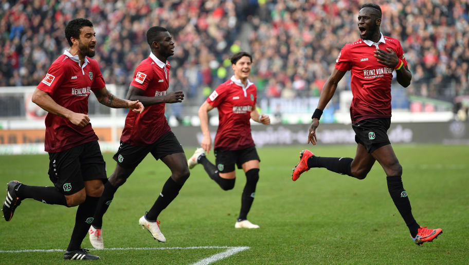 HANOVER, GERMANY - MARCH 10:  Salif SanŽ of Hannover celebrates scoring his goal during the Bundesliga match between Hannover 96 and FC Augsburg at HDI-Arena on March 10, 2018 in Hanover, Germany.  (Photo by Stuart Franklin/Bongarts/Getty Images)