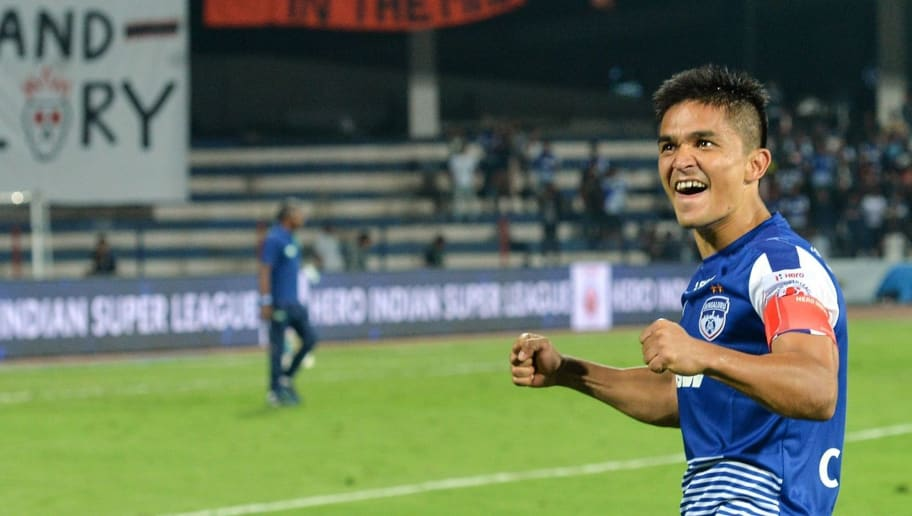 Indian club Bengaluru FC player Sunil Chhetri acknowledges the crowds after the team's 3-1 win against Pune City in the Hero ISL semi finals match at the Sree Kanteerava Stadium, Bangalore on March 11, 2018. Sunil Chhetri alone scored 3 goals against Pune to steer the team to victory. / AFP PHOTO / Manjunath KIRAN        (Photo credit should read MANJUNATH KIRAN/AFP/Getty Images)
