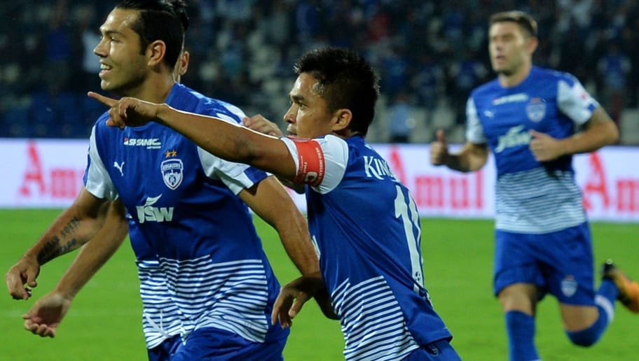 Bengaluru FC captain Sunil Chhetri (C) celebrates the team's first goal with his teammates during the Indian Super League (ISL) final match between Bengaluru FC and Chennayin FC at Sree Kanteerava Stadium in Bangalore on March 17, 2018.  / AFP PHOTO / Manjunath KIRAN / IMAGE RESTRICTED TO EDITORIAL USE - STRICTLY NO COMMERCIAL USE         (Photo credit should read MANJUNATH KIRAN/AFP/Getty Images)