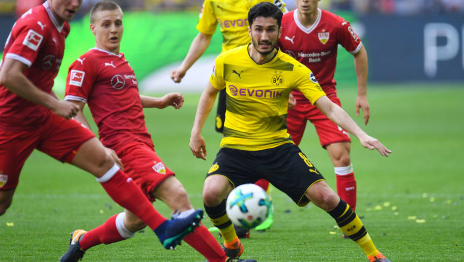 Dortmund's Turkish midfielder Nuri Sahin and Stuttgart's Argentinian midfielder Santiago Ascacibar  vie for the ball during the German first division Bundesliga football match Borussia Dortmund vs VfB Stuttgart, in Dortmund, western Germany, on April 8, 2018. / AFP PHOTO / Patrik STOLLARZ / RESTRICTIONS: DURING MATCH TIME: DFL RULES TO LIMIT THE ONLINE USAGE TO 15 PICTURES PER MATCH AND FORBID IMAGE SEQUENCES TO SIMULATE VIDEO. == RESTRICTED TO EDITORIAL USE == FOR FURTHER QUERIES PLEASE CONTACT DFL DIRECTLY AT + 49 69 650050         (Photo credit should read PATRIK STOLLARZ/AFP/Getty Images)