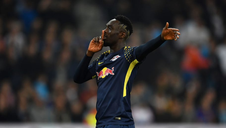 MARSEILLE, FRANCE - APRIL 12:  Jean-Kevin Augustin of RB Leipzig celebrates a goal during the UEFA Europa League quarter final leg two match between Olympique Marseille and RB Leipzig at Stade Velodrome on April 12, 2018 in Marseille, France.  (Photo by Valerio Pennicino/Bongarts/Getty Images)