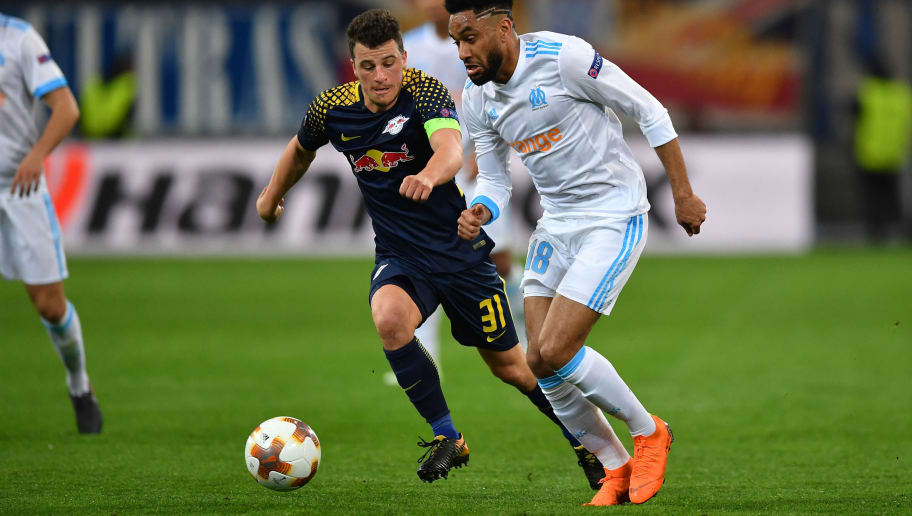 MARSEILLE, FRANCE - APRIL 12:  Jordan Amavi (R) of Olympique Marseille in action against Diego Demme of RB Leipzig during the UEFA Europa League quarter final leg two match between Olympique Marseille and RB Leipzig at Stade Velodrome on April 12, 2018 in Marseille, France.  (Photo by Valerio Pennicino/Bongarts/Getty Images)