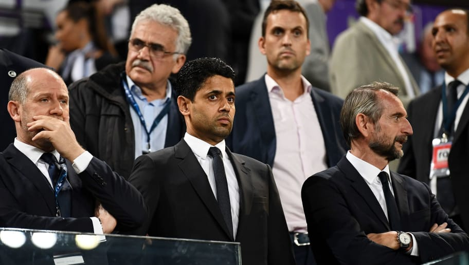 (from L) Paris Saint-Germain's Portiguese sporting director Antero Henrique, Paris Saint-Germain's Qatari president Nasser Al-Khelaifi and Paris Saint-Germain's assistant general manager Jean-Claude Blanc attend the UEFA Champions League Group B football match between RSC Anderlecht and Paris Saint-Germain (PSG) at the Constant Vanden Stock Stadium in Brussels on October 18, 2017.    / AFP PHOTO / FRANCK FIFE        (Photo credit should read FRANCK FIFE/AFP/Getty Images)