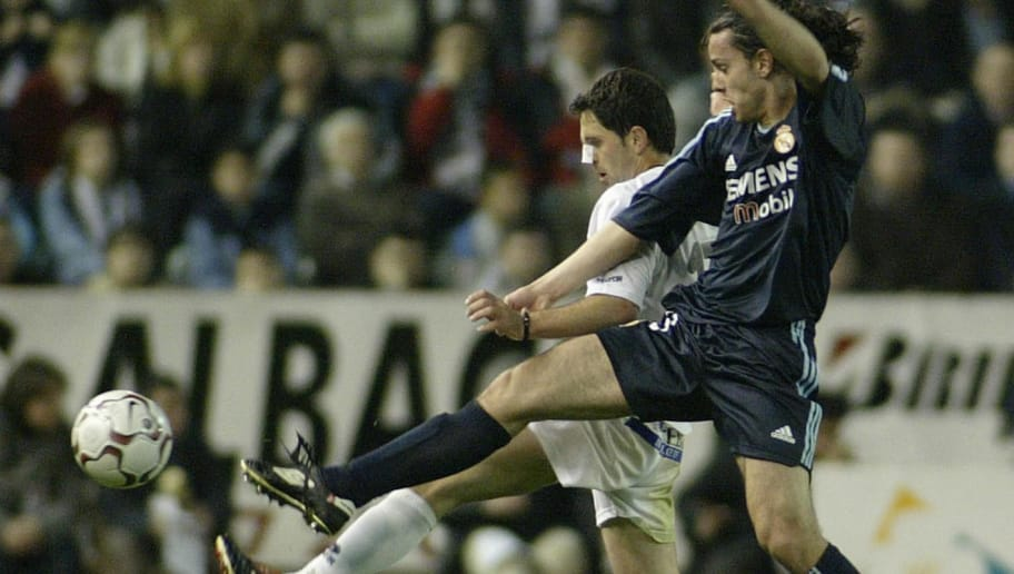 ALBACETE, SPAIN:  Real Madrid's Alvaro Mejia (R) fights for the ball with Albacete's  Romanian Catalin  Munteanu (L) during a Premier league match between Real Madrid and Albacete,in Carlos Baelmonte Stadium  in Albacete ,03 April 2004.AFP PHOTO JOSE JORDAN  (Photo credit should read JOSE JORDAN/AFP/Getty Images)