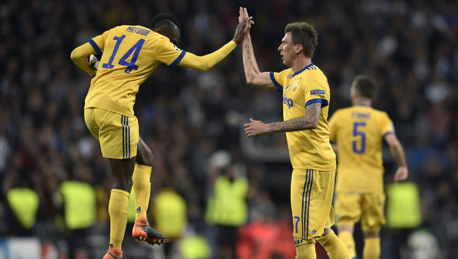 Juventus' Croatian forward Mario Mandzukic (R) celebrates with Juventus' French midfielder Blaise Matuidi after scoring during the UEFA Champions League quarter-final second leg football match between Real Madrid CF and Juventus FC at the Santiago Bernabeu stadium in Madrid on April 11, 2018. / AFP PHOTO / OSCAR DEL POZO        (Photo credit should read OSCAR DEL POZO/AFP/Getty Images)