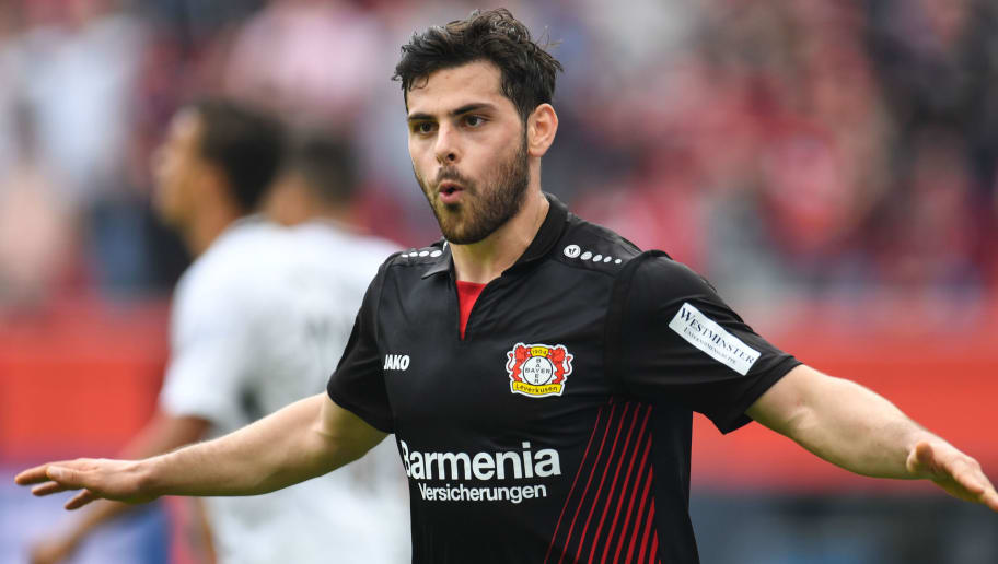 Leverkusen's German forward Kevin Volland celebrates after scoring during the German first division Bundesliga football match Bayer 04 Leverkusen vs Eintracht Frankfurt, in Leverkusen, western Germany, on April 14, 2018. / AFP PHOTO / Patrik STOLLARZ / RESTRICTIONS: DURING MATCH TIME: DFL RULES TO LIMIT THE ONLINE USAGE TO 15 PICTURES PER MATCH AND FORBID IMAGE SEQUENCES TO SIMULATE VIDEO. == RESTRICTED TO EDITORIAL USE == FOR FURTHER QUERIES PLEASE CONTACT DFL DIRECTLY AT + 49 69 650050         (Photo credit should read PATRIK STOLLARZ/AFP/Getty Images)