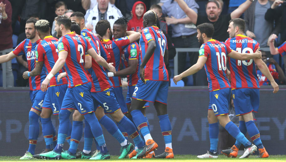 LONDON, ENGLAND - APRIL 14:  Wilfried Zaha of Crystal Palace celebrates with teammates after scoring his sides first goal during the Premier League match between Crystal Palace and Brighton and Hove Albion at Selhurst Park on April 14, 2018 in London, England.  (Photo by Bryn Lennon/Getty Images)
