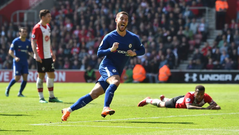 Chelsea's Belgian midfielder Eden Hazard (C) celecrates scoring their second goal to equalise 2-2 during the English Premier League football match between Southampton and Chelsea at St Mary's Stadium in Southampton, southern England on April 14, 2018. / AFP PHOTO / Glyn KIRK / RESTRICTED TO EDITORIAL USE. No use with unauthorized audio, video, data, fixture lists, club/league logos or 'live' services. Online in-match use limited to 75 images, no video emulation. No use in betting, games or single club/league/player publications.  /         (Photo credit should read GLYN KIRK/AFP/Getty Images)
