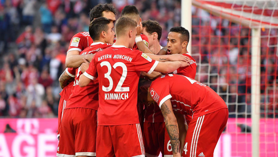 MUNICH, GERMANY - APRIL 14: Thiago Alcantara of Bayern Muenchen (r) is celebrates by his team after he scored a goal to make it 3:1 during the Bundesliga match between FC Bayern Muenchen and Borussia Moenchengladbach at Allianz Arena on April 14, 2018 in Munich, Germany. (Photo by Sebastian Widmann/Bongarts/Getty Images,)