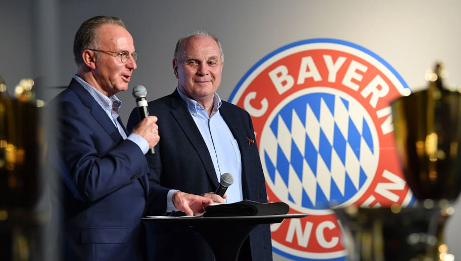 MUNICH, GERMANY - MARCH 10:  Karl-Heinz Rummenigge (left) and Uli Hoeness during a reception in honor of the heroes of the 1957 (German Cup Winners) and 1967 (European Cup Winners) teams at the Erlebniswelt, during the Bundesliga match between FC Bayern Muenchen and Hamburger SV at Allianz Arena on March 10, 2018 in Munich, Germany. (Photo by Sebastian Widmann/Bongarts/Getty Images)