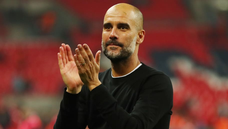 LONDON, ENGLAND - APRIL 14: Josep Guardiola, Manager of Manchester City shows appreciation to the fans after the Premier League match between Tottenham Hotspur and Manchester City at Wembley Stadium on April 14, 2018 in London, England.  (Photo by Catherine Ivill/Getty Images)