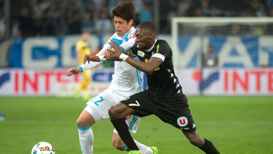 Olympique de Marseille's Japanese defender Hiroki Sakai (L) vies with Angers' Cameroonian forward Karl Toko Ekambi during the French L1 football match Olympique de Marseille vs Angers on March 10, 2017 at the Velodrome stadium in Marseille, southern France.  / AFP PHOTO / BERTRAND LANGLOIS        (Photo credit should read BERTRAND LANGLOIS/AFP/Getty Images)