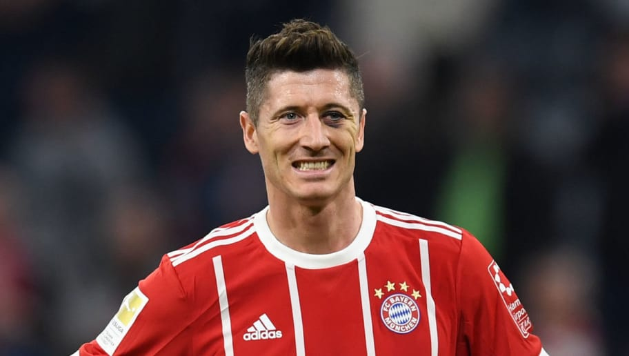 Bayern Munich's Polish forward Robert Lewandowski reacts during the German first division Bundesliga football match FC Bayern Munich vs Borussia Moenchengladbach in Munich, southern Germany, on April 14, 2018.  / AFP PHOTO / Christof STACHE / RESTRICTIONS: DURING MATCH TIME: DFL RULES TO LIMIT THE ONLINE USAGE TO 15 PICTURES PER MATCH AND FORBID IMAGE SEQUENCES TO SIMULATE VIDEO. == RESTRICTED TO EDITORIAL USE == FOR FURTHER QUERIES PLEASE CONTACT DFL DIRECTLY AT + 49 69 650050  / RESTRICTIONS: DURING MATCH TIME: DFL RULES TO LIMIT THE ONLINE USAGE TO 15 PICTURES PER MATCH AND FORBID IMAGE SEQUENCES TO SIMULATE VIDEO. == RESTRICTED TO EDITORIAL USE == FOR FURTHER QUERIES PLEASE CONTACT DFL DIRECTLY AT + 49 69 650050        (Photo credit should read CHRISTOF STACHE/AFP/Getty Images)