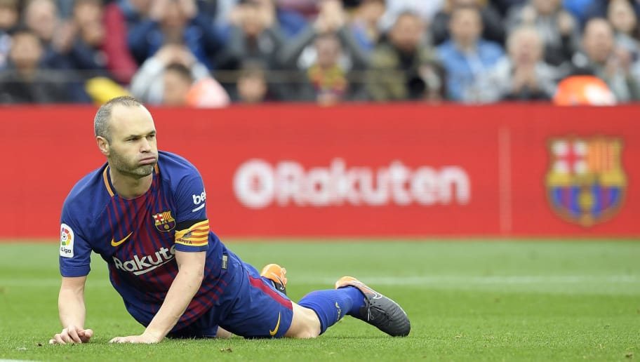 Barcelona's Spanish midfielder Andres Iniesta lies on the field during the Spanish league footbal match between FC Barcelona and Valencia CF at the Camp Nou stadium in Barcelona on April 14, 2018. / AFP PHOTO / LLUIS GENE        (Photo credit should read LLUIS GENE/AFP/Getty Images)