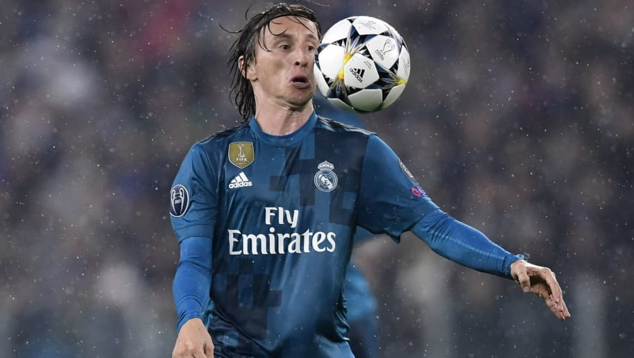 Real Madrid's Croatian midfielder Luka Modric controls the ball during the UEFA Champions League quarter-final first leg football match between Juventus and Real Madrid at the Allianz Stadium in Turin on April 3, 2018. / AFP PHOTO / JAVIER SORIANO        (Photo credit should read JAVIER SORIANO/AFP/Getty Images)