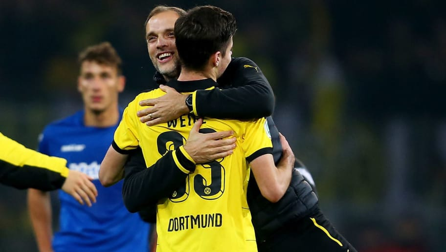 DORTMUND, GERMANY - OCTOBER 28: Head coach Thomas Tuchel of Dortmund (R) embraces Julian Weigl (L) after the DFB Cup match between Borussia Dortmund and SC Paderborn at Signal Iduna Park on October 28, 2015 in Dortmund, Germany. The match between Dortmund and Paderborn ended 7-1. (Photo by Christof Koepsel/Bongarts/Getty Images)