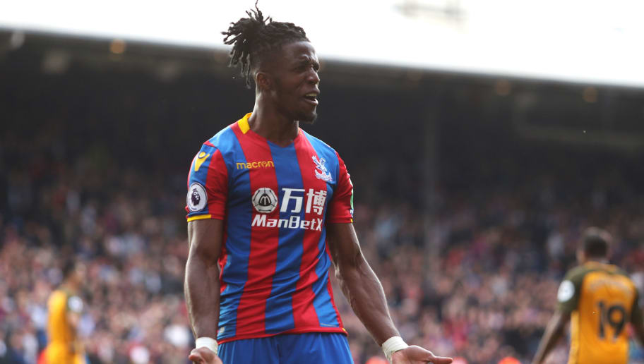 LONDON, ENGLAND - APRIL 14:  Wilfried Zaha of Crystal Palace reacts during the Premier League match between Crystal Palace and Brighton and Hove Albion at Selhurst Park on April 14, 2018 in London, England.  (Photo by Christopher Lee/Getty Images)