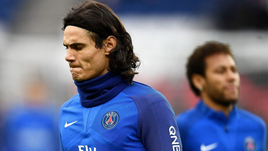 Paris Saint-Germain's Uruguayan forward Edinson Cavani (L) and Paris Saint-Germain's Brazilian forward Neymar warm up ahead of the the French L1 football match between Paris Saint-Germain (PSG) and Montpellier (MHSC) at the Parc des Princes stadium in Paris on January 27, 2018. / AFP PHOTO / FRANCK FIFE        (Photo credit should read FRANCK FIFE/AFP/Getty Images)