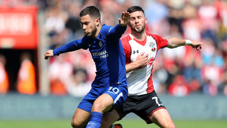 SOUTHAMPTON, ENGLAND - APRIL 14:  Eden Hazard of Chelsea is challenged by Shane Long of Southampton during the Premier League match between Southampton and Chelsea at St Mary's Stadium on April 14, 2018 in Southampton, England.  (Photo by Warren Little/Getty Images)