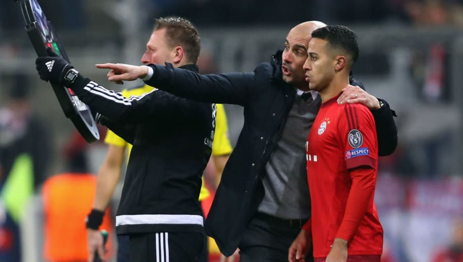 MUNICH, GERMANY - MARCH 16:  Head coach Pep Guardiola of Muenchen talks to Thiago Alcantara during the UEFA Champions League Round of 16 Second Leg match between FC Bayern Muenchen and Juventus at Allianz Arena on March 16, 2016 in Munich, Germany.  (Photo by Alex Grimm/Bongarts/Getty Images)