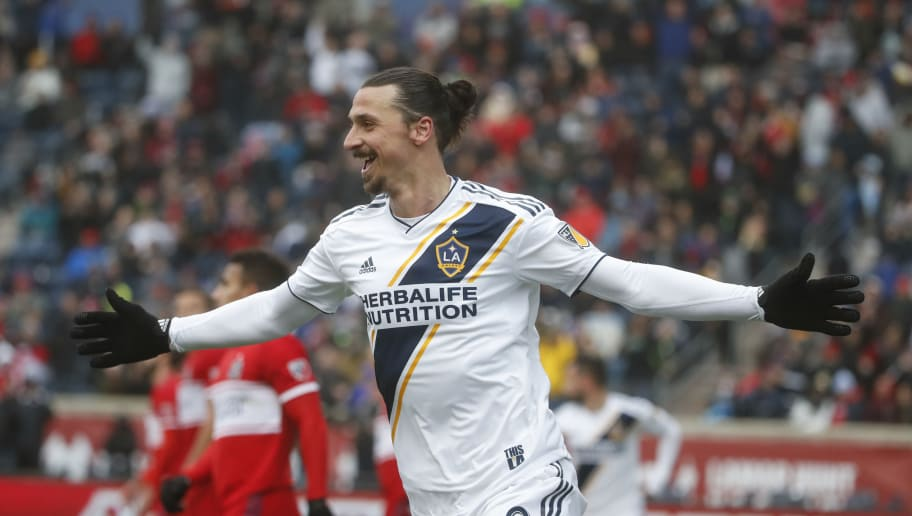 Zlatan Ibrahimovic of Los Angeles Galaxy celebrates after scoring against the Chicago Fire during the first half of a MLS soccer match on April 14, 2018 at the Toyota Park in Bridgeview, Illinois.  / AFP PHOTO / Kamil Krzaczynski        (Photo credit should read KAMIL KRZACZYNSKI/AFP/Getty Images)