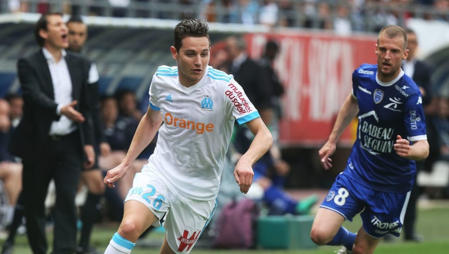 Marseille's French midfielder Florian Thauvin (L) vies for the ball with Troyes' French midfielder Stephane Darbion (R) during the French L1 football match between Troyes (ESTAC) and Marseille (OM) on April 15, 2018, at the Aube Stadium in Troyes, eastern France. / AFP PHOTO / FRANCOIS NASCIMBENI        (Photo credit should read FRANCOIS NASCIMBENI/AFP/Getty Images)