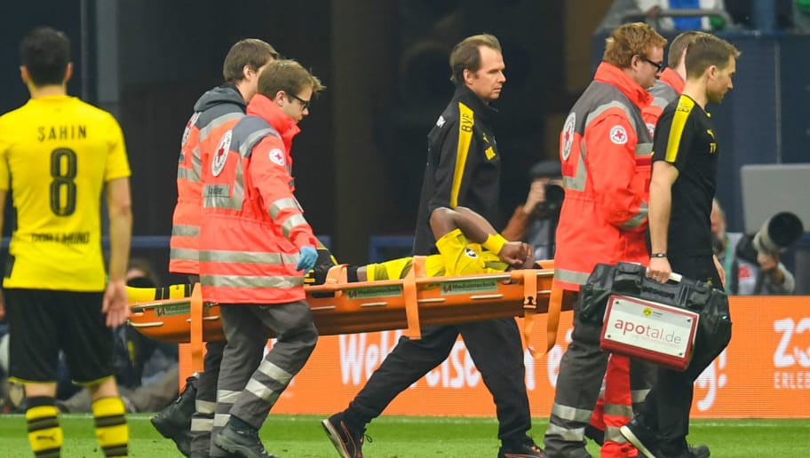 Dortmund's Belgian striker Michy Batshuayi is stretchered off by medics from the pitch during the German first division Bundesliga football match FC Schalke 04 vs Borussia Dortmund, in Gelsenkirchen, western Germany, on April 15, 2018. / AFP PHOTO / Patrik STOLLARZ / RESTRICTIONS: DURING MATCH TIME: DFL RULES TO LIMIT THE ONLINE USAGE TO 15 PICTURES PER MATCH AND FORBID IMAGE SEQUENCES TO SIMULATE VIDEO. == RESTRICTED TO EDITORIAL USE == FOR FURTHER QUERIES PLEASE CONTACT DFL DIRECTLY AT + 49 69 650050         (Photo credit should read PATRIK STOLLARZ/AFP/Getty Images)