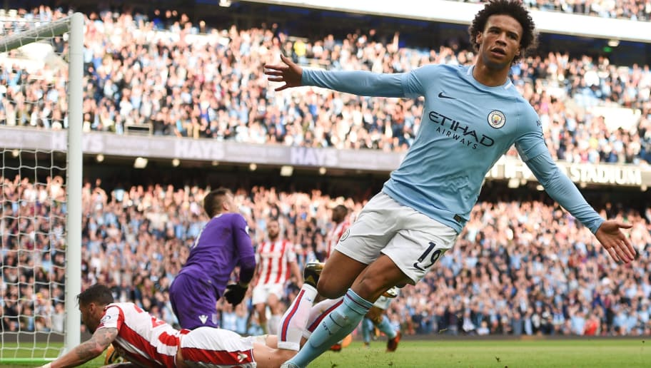 Manchester City's German midfielder Leroy Sane scores their sixth goal during the English Premier League football match between Manchester City and Stoke City at the Etihad Stadium in Manchester, north west England, on October 14, 2017. / AFP PHOTO / Oli SCARFF / RESTRICTED TO EDITORIAL USE. No use with unauthorized audio, video, data, fixture lists, club/league logos or 'live' services. Online in-match use limited to 75 images, no video emulation. No use in betting, games or single club/league/player publications.  /         (Photo credit should read OLI SCARFF/AFP/Getty Images)