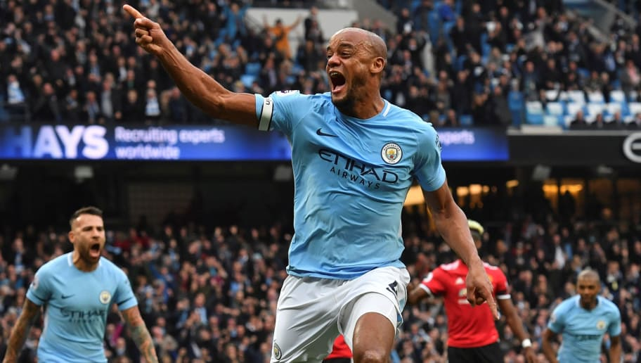 Manchester City's Belgian defender Vincent Kompany celebrates scoring the opening goal during the English Premier League football match between Manchester City and Manchester United at the Etihad Stadium in Manchester, north west England, on April 7, 2018. / AFP PHOTO / Ben STANSALL / RESTRICTED TO EDITORIAL USE. No use with unauthorized audio, video, data, fixture lists, club/league logos or 'live' services. Online in-match use limited to 75 images, no video emulation. No use in betting, games or single club/league/player publications.  /         (Photo credit should read BEN STANSALL/AFP/Getty Images)