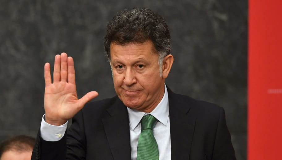 Mexico's national team football coach Colombian Juan Carlos Osorio waves during the FIFA World Cup trophy presentation at the Presidential Palace of Los Pinos in Mexico City, on April 11, 2018. The FIFA World Cup trophy tours 91 cities in 51 countries during a three-month period before the start of the World Cup in Russia. / AFP PHOTO / YURI CORTEZ        (Photo credit should read YURI CORTEZ/AFP/Getty Images)