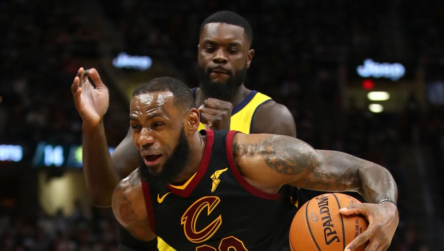 CLEVELAND, OH - APRIL 15:  LeBron James #23 of the Cleveland Cavaliers drives past Lance Stephenson #1 of the Indiana Pacers during the second half in Game One of the Eastern Conference Quarterfinals during the 2018 NBA Playoffs at Quicken Loans Arena on April 15, 2018 in Cleveland, Ohio. Indiana won the game 98-80 to take a 1-0 series lead. NOTE TO USER: User expressly acknowledges and agrees that, by downloading and or using this photograph, User is consenting to the terms and conditions of the Getty Images License Agreement. (Photo by Gregory Shamus/Getty Images)