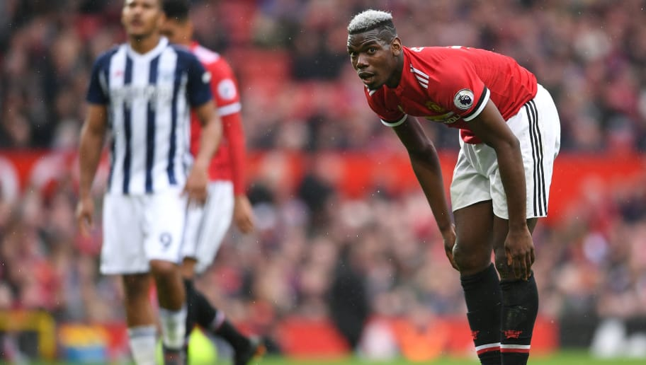 MANCHESTER, ENGLAND - APRIL 15:  Paul Pogba of Manchester United reacts during the Premier League match between Manchester United and West Bromwich Albion at Old Trafford on April 15, 2018 in Manchester, England.  (Photo by Laurence Griffiths/Getty Images)