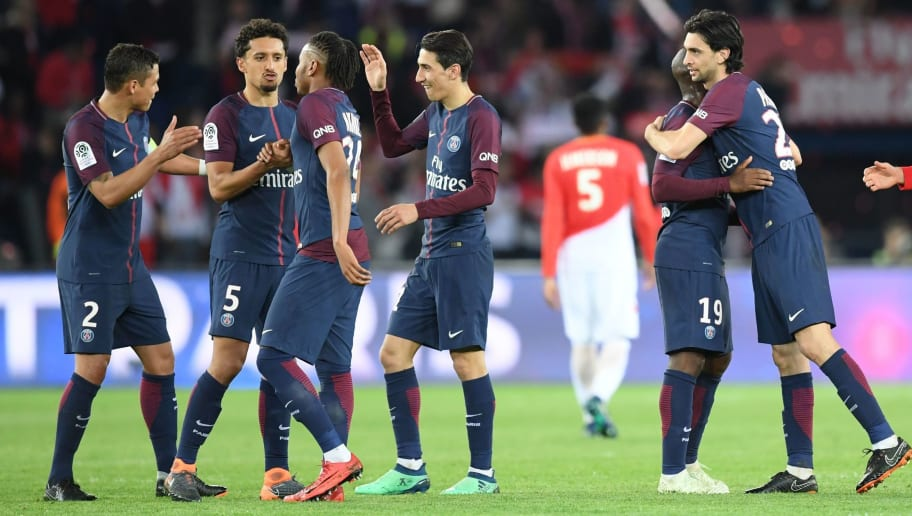 Paris Saint-Germain's players celebrate after winning the French L1 football match between Paris Saint-Germain (PSG) and Monaco (ASM) on April 15, 2018, at the Parc des Princes stadium in Paris. Paris Saint-Germain won the match and claimed their seventh French League title.  / AFP PHOTO / CHRISTOPHE ARCHAMBAULT        (Photo credit should read CHRISTOPHE ARCHAMBAULT/AFP/Getty Images)