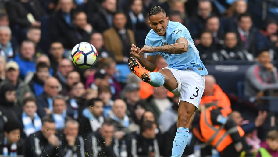 Manchester City's Brazilian defender Danilo plays the ball during the English Premier League football match between Manchester City and Manchester United at the Etihad Stadium in Manchester, north west England, on April 7, 2018. / AFP PHOTO / Ben STANSALL / RESTRICTED TO EDITORIAL USE. No use with unauthorized audio, video, data, fixture lists, club/league logos or 'live' services. Online in-match use limited to 75 images, no video emulation. No use in betting, games or single club/league/player publications.  /         (Photo credit should read BEN STANSALL/AFP/Getty Images)