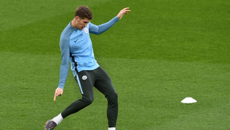 Manchester City's English defender John Stones participates in a training session on the eve of the UEFA Champions League first leg quarter-final football match between Liverpool and Manchester City, at Anfield stadium in Liverpool, north west England on April 3, 2018. / AFP PHOTO / PAUL ELLIS        (Photo credit should read PAUL ELLIS/AFP/Getty Images)