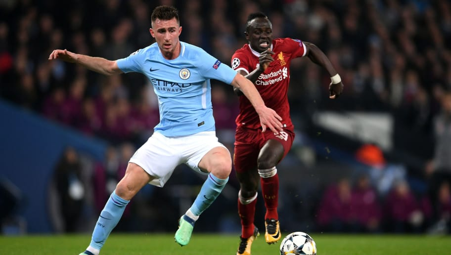 MANCHESTER, ENGLAND - APRIL 10:  Aymeric Laporte of Manchester City battles for posession with Sadio Mane  during the UEFA Champions League Quarter Final Second Leg match between Manchester City and Liverpool at Etihad Stadium on April 10, 2018 in Manchester, England.  (Photo by Laurence Griffiths/Getty Images,)