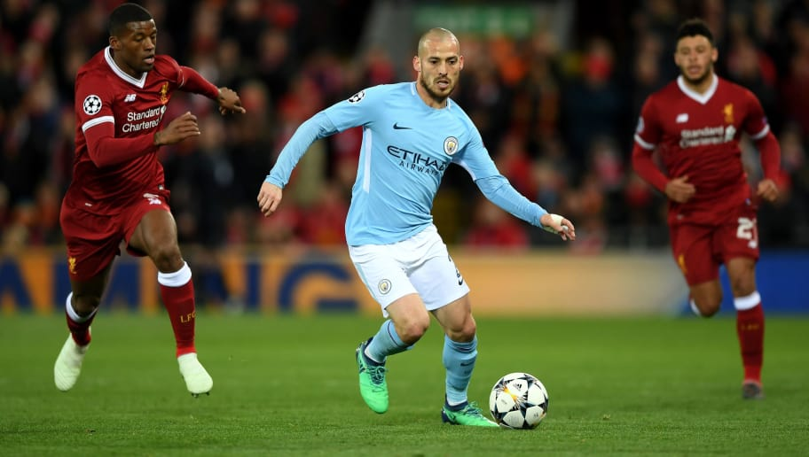 LIVERPOOL, ENGLAND - APRIL 04: David Silva of Manchester City runs with the ball during the UEFA Champions League Quarter Final Leg One match between Liverpool and Manchester City at Anfield on April 4, 2018 in Liverpool, England.  (Photo by Shaun Botterill/Getty Images)