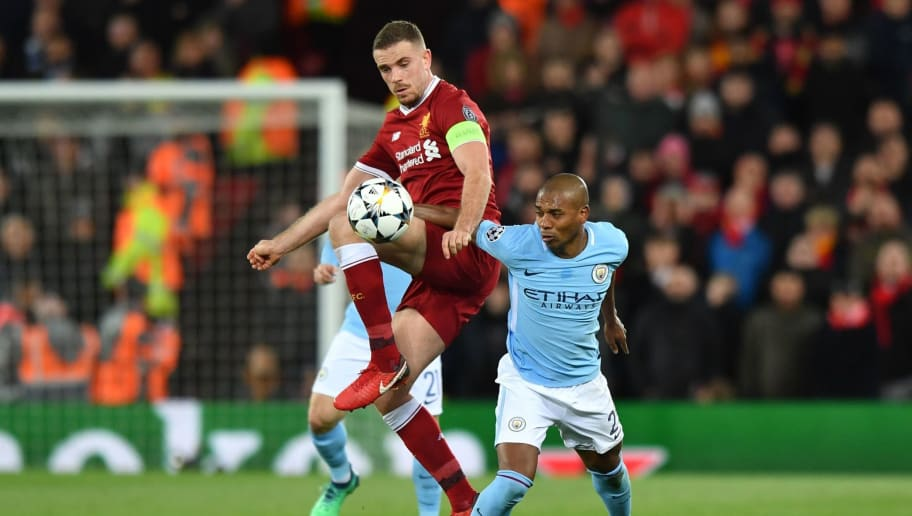 Manchester City's Brazilian midfielder Fernandinho (R) vies with Liverpool's English midfielder Jordan Henderson during the UEFA Champions League first leg quarter-final football match between Liverpool and Manchester City, at Anfield stadium in Liverpool, north west England on April 4, 2018. / AFP PHOTO / Anthony Devlin        (Photo credit should read ANTHONY DEVLIN/AFP/Getty Images)