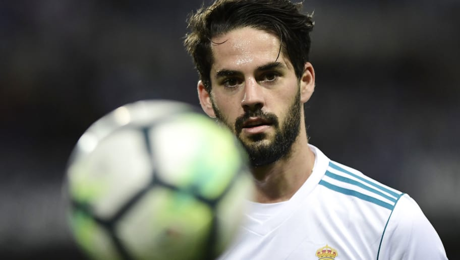 Real Madrid's Spanish midfielder Isco eyes the ball during the Spanish league footbal match between Malaga CF and Real Madrid CF at La Rosaleda stadium in Malaga on April 15, 2018. / AFP PHOTO / JORGE GUERRERO        (Photo credit should read JORGE GUERRERO/AFP/Getty Images)