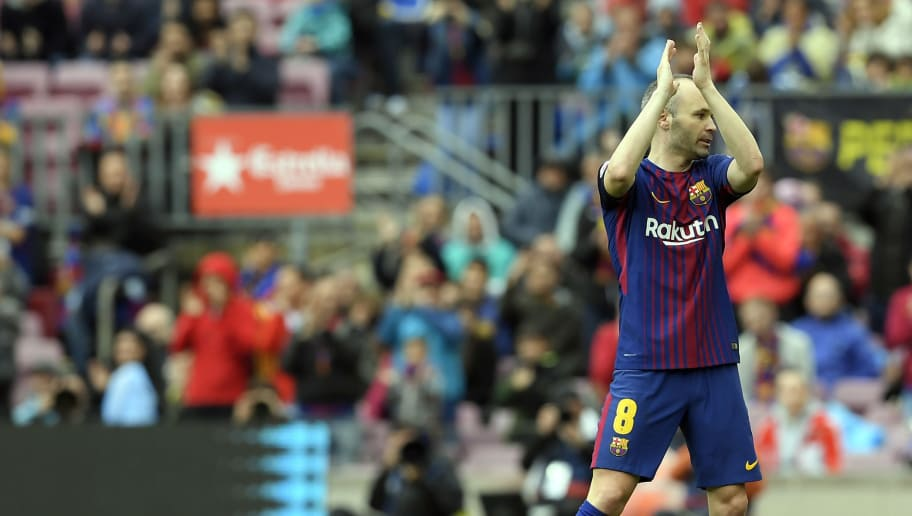 Barcelona's Spanish midfielder Andres Iniesta applauds as he leaves the pitch during the Spanish league footbal match between FC Barcelona and Valencia CF at the Camp Nou stadium in Barcelona on April 14, 2018. / AFP PHOTO / LLUIS GENE        (Photo credit should read LLUIS GENE/AFP/Getty Images)