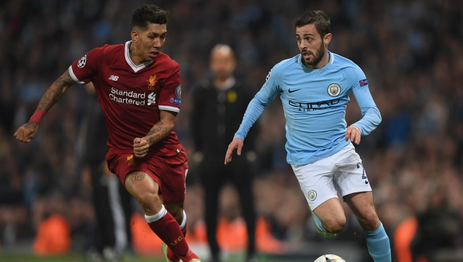 MANCHESTER, ENGLAND - APRIL 10:  Bernardo Silva of Manchester City breaks away from Roberto Firmino of Liverpool during the UEFA Champions League Quarter Final Second Leg match between Manchester City and Liverpool  at Etihad Stadium on April 10, 2018 in Manchester, England.  (Photo by Shaun Botterill/Getty Images,)