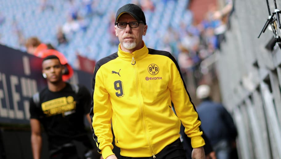 GELSENKIRCHEN, GERMANY - APRIL 15: Head coach Peter Stoeger of Dortmund looks on prior to the Bundesliga match between FC Schalke 04 and Borussia Dortmund at Veltins-Arena on April 15, 2018 in Gelsenkirchen, Germany. (Photo by Christof Koepsel/Bongarts/Getty Images)