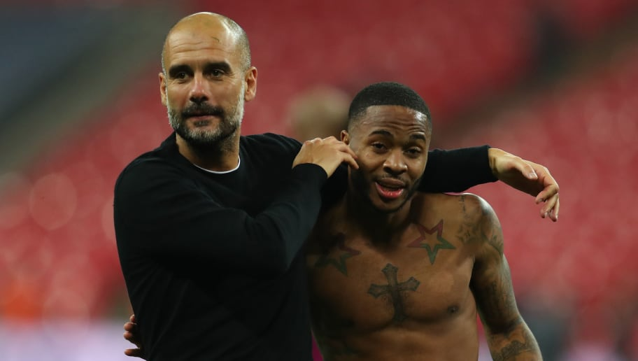 LONDON, ENGLAND - APRIL 14:  Josep Guardiola, Manager of Manchester City celebrates victory with Raheem Sterling of Manchester City after the Premier League match between Tottenham Hotspur and Manchester City at Wembley Stadium on April 14, 2018 in London, England.  (Photo by Catherine Ivill/Getty Images)