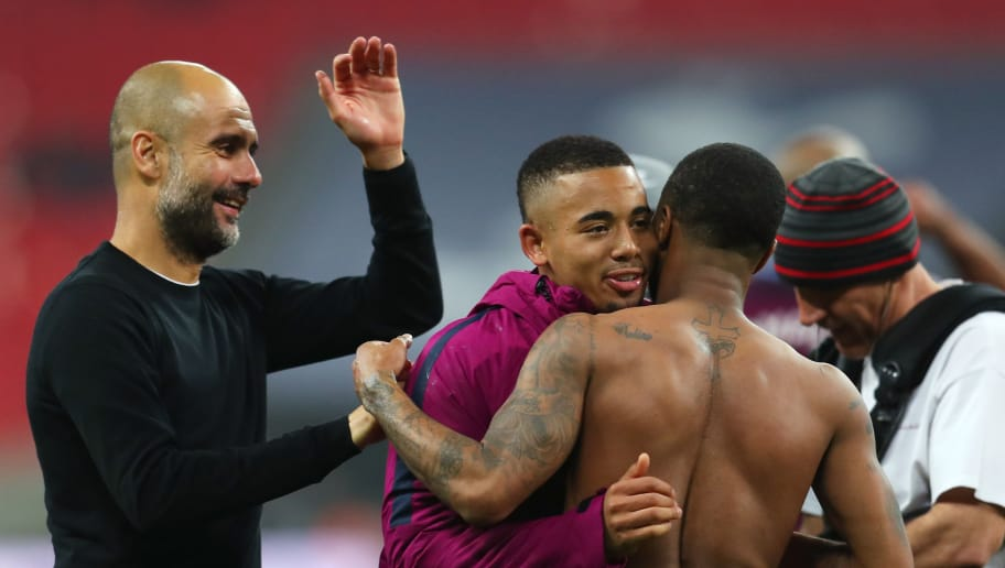 LONDON, ENGLAND - APRIL 14: Josep Guardiola, Manager of Manchester City celebrates victory with Gabriel Jesus of Manchester Cty and Raheem Sterling of Manchester City during the Premier League match between Tottenham Hotspur and Manchester City at Wembley Stadium on April 14, 2018 in London, England.  (Photo by Catherine Ivill/Getty Images)