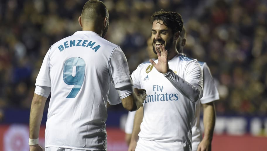 Real Madrid's midfielder Isco (R) celebrates with Real Madrid's French forward Karim Benzema after scoring during the Spanish league football match between Levante UD and Real Madrid CF at the Ciutat de Valencia stadium in Valencia on February 03, 2018. / AFP PHOTO / JOSE JORDAN        (Photo credit should read JOSE JORDAN/AFP/Getty Images)