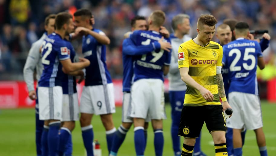 GELSENKIRCHEN, GERMANY - APRIL 15: Marco Reus of Dortmund looks dejected2 after losing 0-2 the Bundesliga match between FC Schalke 04 and Borussia Dortmund at Veltins-Arena on April 15, 2018 in Gelsenkirchen, Germany. (Photo by Christof Koepsel/Bongarts/Getty Images)