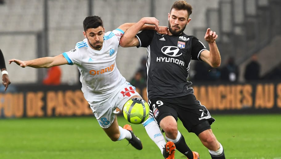 TOPSHOT - Olympique de Marseille's French midfielder Morgan Sanson (L) vies with Lyon's French midfielder Lucas Tousart (R)  during the French L1 football match Marseille (OM) vs Lyon (OL) on March 18, 2018 at the Velodrome stadium in Marseille, southern France. / AFP PHOTO / ANNE-CHRISTINE POUJOULAT        (Photo credit should read ANNE-CHRISTINE POUJOULAT/AFP/Getty Images)