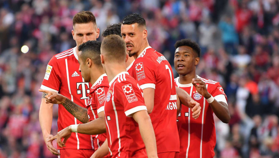 MUNICH, GERMANY - APRIL 14: Players of Bayern Muenchen celebrate after their third goal during the Bundesliga match between FC Bayern Muenchen and Borussia Moenchengladbach at Allianz Arena on April 14, 2018 in Munich, Germany. (Photo by Sebastian Widmann/Bongarts/Getty Images,)