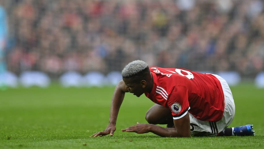 Manchester United's French midfielder Paul Pogba picks himself up off the floor during the English Premier League football match between Manchester United and West Bomwich Albion at Old Trafford in Manchester, north west England, on April 15, 2018. / AFP PHOTO / Paul ELLIS / RESTRICTED TO EDITORIAL USE. No use with unauthorized audio, video, data, fixture lists, club/league logos or 'live' services. Online in-match use limited to 75 images, no video emulation. No use in betting, games or single club/league/player publications.  /         (Photo credit should read PAUL ELLIS/AFP/Getty Images)